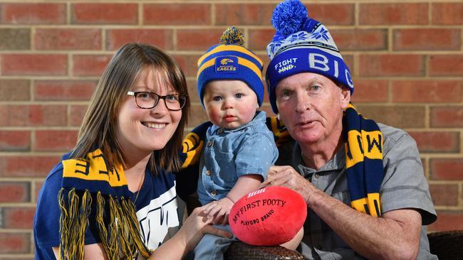 Graham Johnson with his daughter Rebecca Leach and grandson Hunter. Image: AAP/Keryn Stevens
