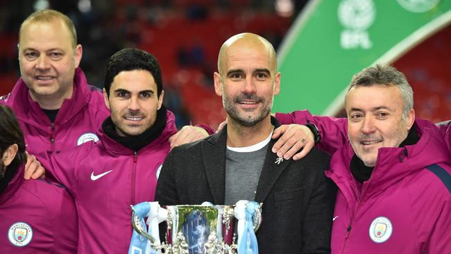 Arteta on the left of Manchester City's Spanish manager Pep Guardiola