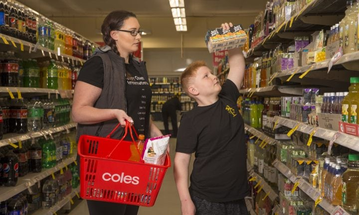 "Coles Ringwood Square has launched a ""quiet hour"" to make shopping easier for people with autism. Pictured are Emily, and her son Lachlan, who has autism and has benefitted greatly from the program. Ringwood, Melbourne. Tuesday August 22nd 2017. Photo: Daniel Pockett"