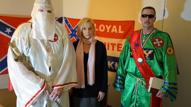60 Minutes' Liz Hayes flanked by members of the Royal White Knights, including Orange County Ku Klux Klan Grand Dragon Will Quigg (right). Picture: Channel 9