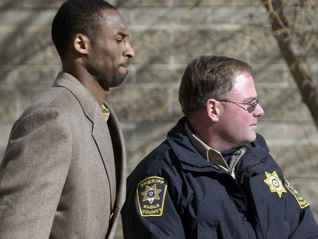 Kobe Bryant leaves court during his civil hearing in 2003.