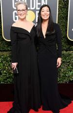 Actor Meryl Streep (L) and NDWA Director Ai-jen Poo attend The 75th Annual Golden Globe Awards at The Beverly Hilton Hotel on January 7, 2018 in Beverly Hills, California. Picture: Frazer Harrison/Getty Images/AFP