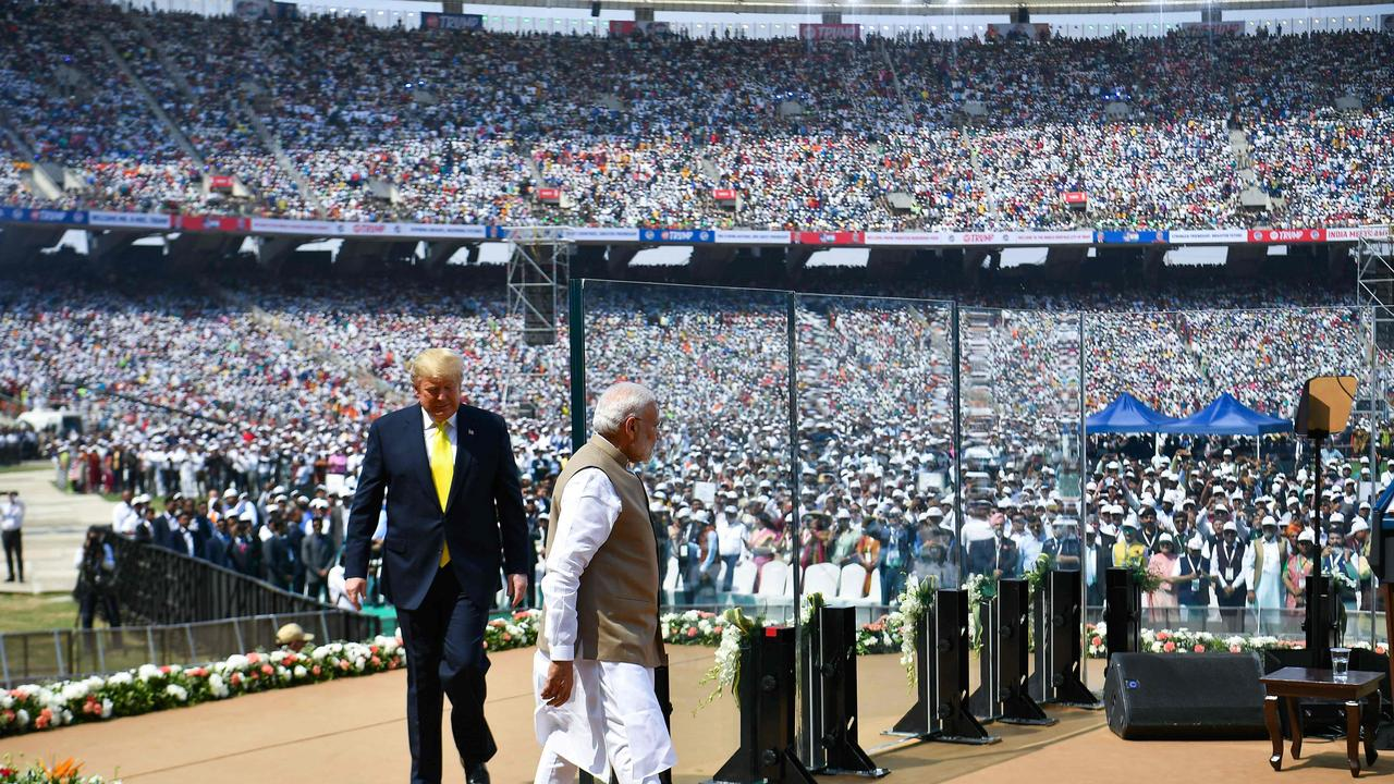 Former USA President Donald Trump (L) and India's Prime Minister Narendra Modi (C) arriving to attend the 'Namaste Trump' rally at Sardar Patel Stadium on February 24, 2020.