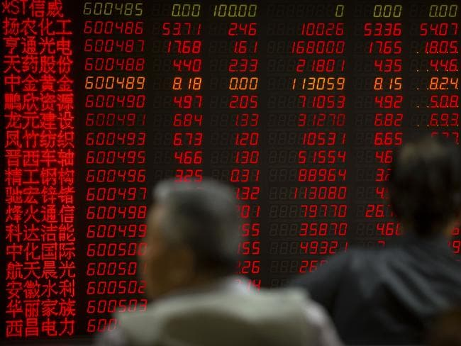Chinese investors monitor stock prices at a brokerage house in Beijing, after President Donald Trump increased tariffs on $200 billion in Chinese imports. Picture: AP