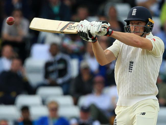 England's Jos Buttler plays a shot during play on the second day.