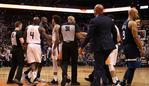 PHOENIX, ARIZONA - JANUARY 22: Gorgui Dieng #5 of the Minnesota Timberwolves reacts to Kelly Oubre Jr. #3 and Quincy Acy #4 of the Phoenix Suns after Dieng was ejected with Devin Booker #1 during the second half of the NBA game at Talking Stick Resort Arena on January 22, 2019 in Phoenix, Arizona. The Timberwolves defeated the Suns 118-91. Christian Petersen/Getty Images/AFP == FOR NEWSPAPERS, INTERNET, TELCOS & TELEVISION USE ONLY ==