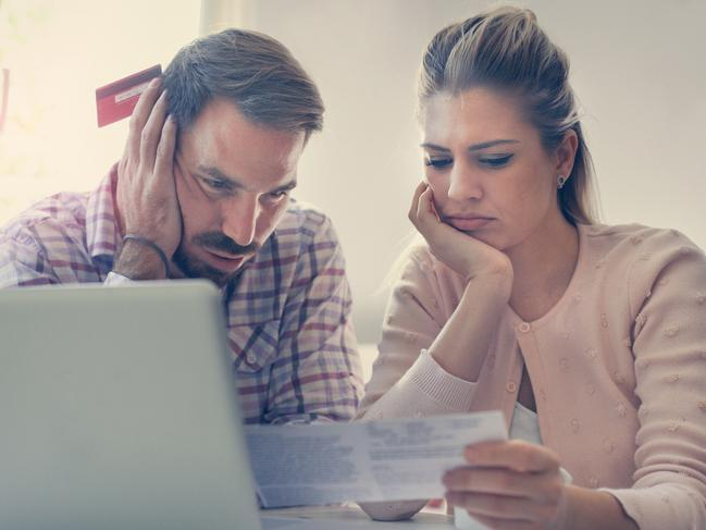 You should always read the fine print before entering into a debt consolidation agreement. Picture: iStock.