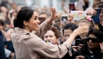 Meghan greets the thousands of fans who turned out to see her and Harry at the Viaduct in Auckland. Source: Getty Images