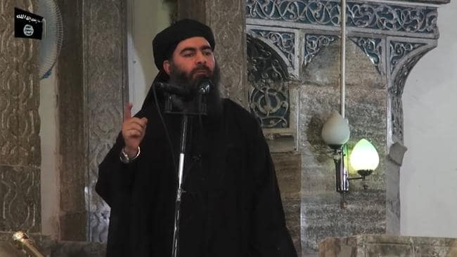 Abu Bakr al-Baghdadi in July 2014 addressing Muslim worshippers in Mosul. Picture: AFP