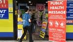 A man enters a pharmacy in Sydney on March 27, 2020, as people stay away due to restrictions to stop the spread of the worldwide COVID-19 coronavirus outbreak. - The number of confirmed covid-19 cases in Australia passed the 3,000 mark on March 27, with the vast majority of infections in major east coast cities like Sydney, Brisbane and Melbourne. (Photo by Saeed KHAN / AFP)