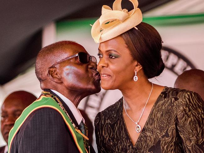 Former Zimbabwe President Robert Mugabe kisses his wife and first lady Grace Mugabe. Many hoped his fall would mark a new era for the country. Picture: AFP