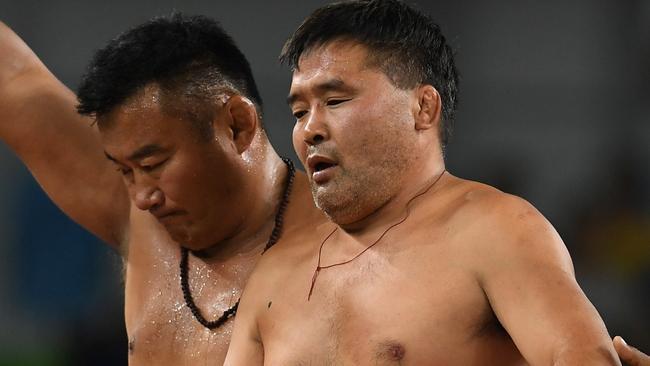Mongolia wrestling coaches strip in Rio Olympics bronze