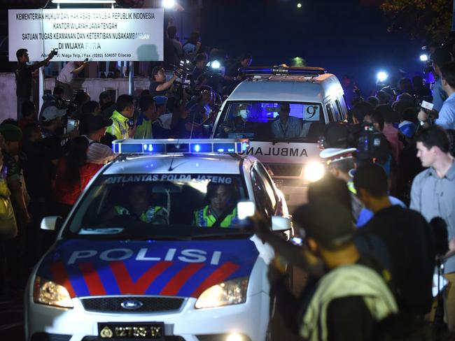 The pain will never end ... A police car escorts an ambulance carrying a coffin bearing the body of one of the eight drug convicts executed at Nusakambangan on April 29, 2015. Picture: AFP / Romeo Gacad