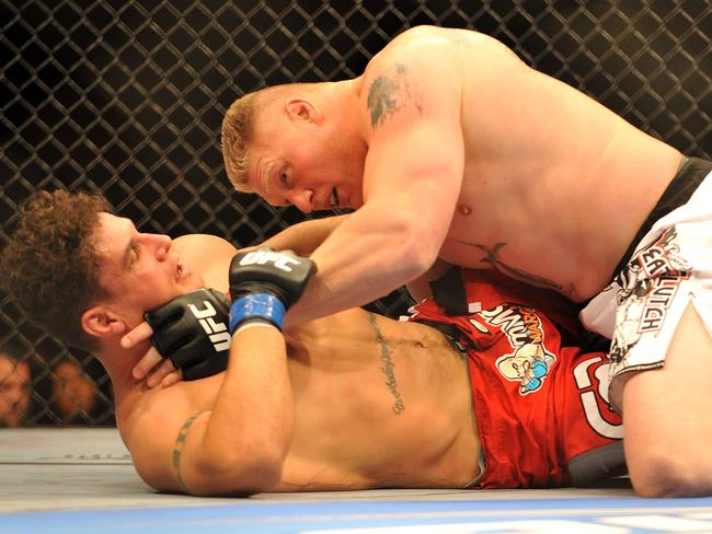 Brock Lesnar holds down Frank Mir during their heavyweight title bout during UFC 100 in 2009.