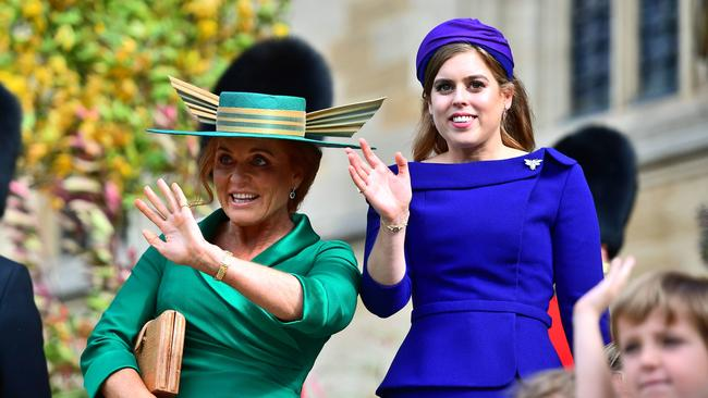Sarah Ferguson, Duchess of York and Princess Beatrice of York attend the wedding of Princess Eugenie of York to Jack Brooksbank.