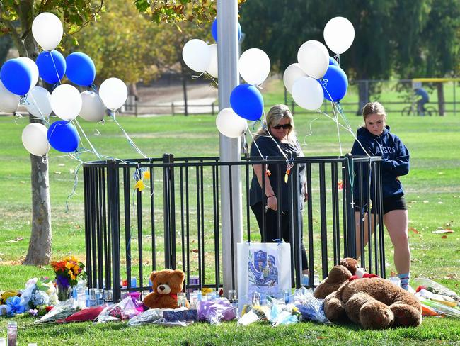 People visit a makeshift memorial at Central Park in Santa Clarita, California, after the Saugus High school shooting. Picture: AFP