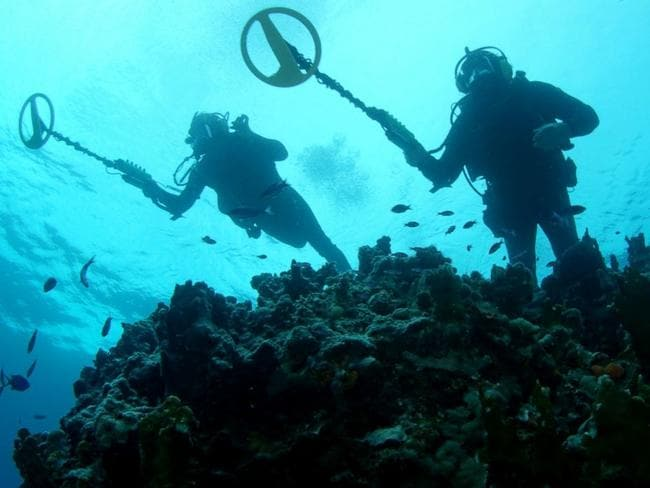 Underwater treasure hunters scan the sea.