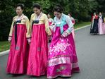 North Korean women in traditional dress walk to pay their respects to the Mansudae Grand Monument, huge statues of Kim Il-sung and Kim Jong-il. Picture: Carl Court/Getty Images