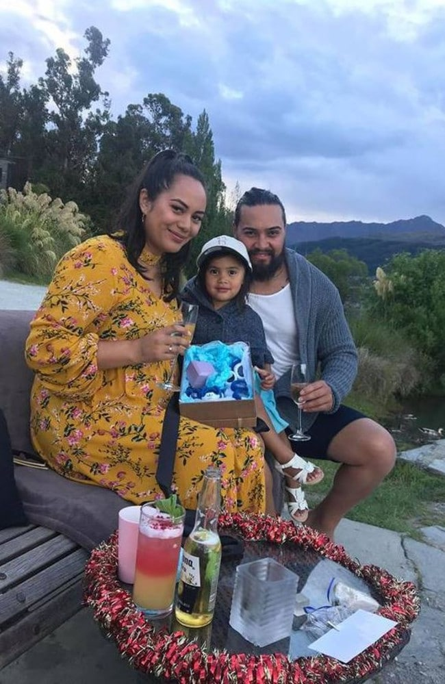 The couple with little Te Aroha and the box that revealed they are about to have a boy. Picture: Facebook