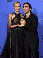 """Diane Kruger and Fatih Akin poses in the press room with the award for best motion picture - foreign language for """"In The Fade"""" at the 75th annual Golden Globe Awards. Picture: AP"""