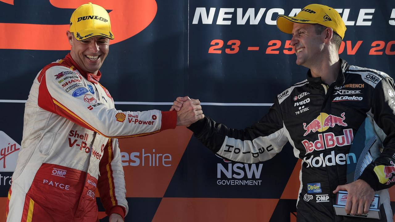 Jamie Whincup congratulates Scott McLaughlin on his 2018 title win.