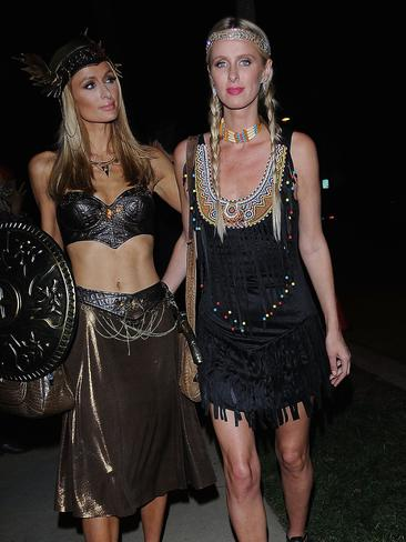 Paris and Nicky Hilton attend a Halloween party on Friday night.