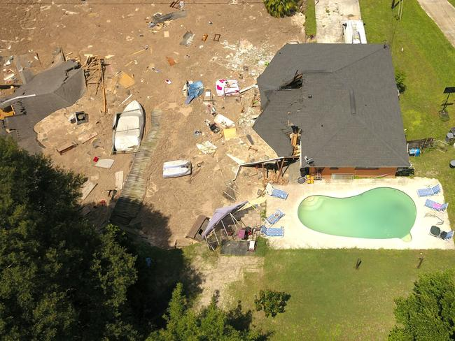 In this aerial photo, debris is strewn about after a sinkhole damaged two homes. Picture: Luis Santana/Tampa Bay Times via AP