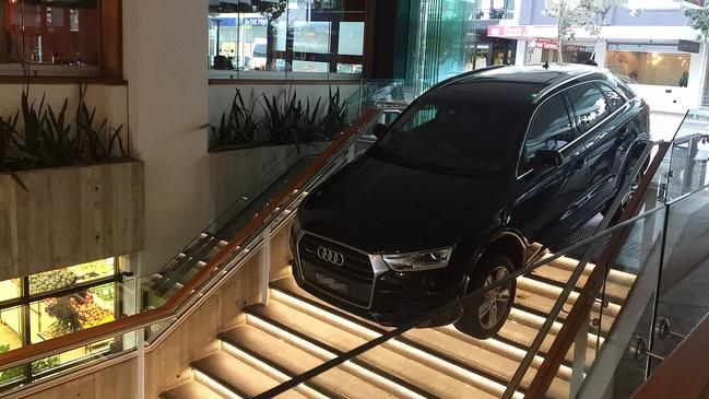 The car ran off the road and into a complex on Hall Sy. Picture: AAP Image