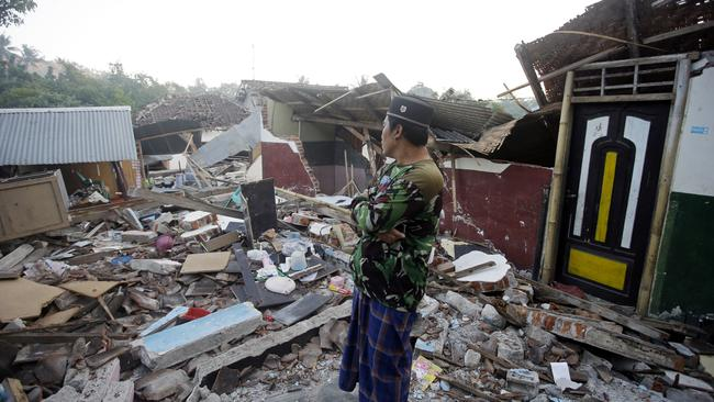 A man inspects the ruin of his house destroyed by Sunday's earthquake in North Lombok. Picture: AP/Firdia Lisnawati