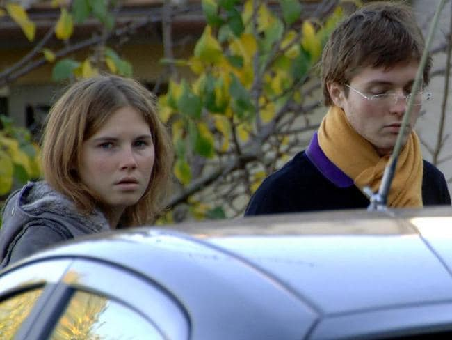 Amanda Knox, left, and Raffaele Sollecito, are seen outside the rented house where Meredith Kercher was found dead in Perugia, Italy. Picture: AP