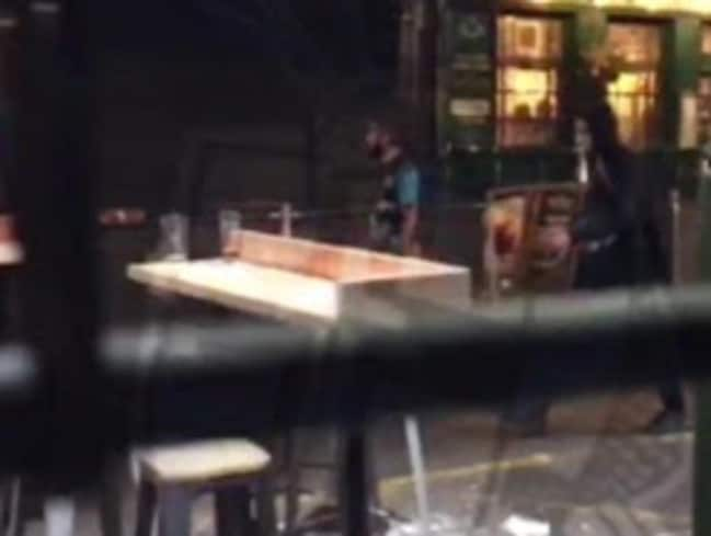 Terrorists seen calmly walking past bars during rampage. Picture: Daily Express