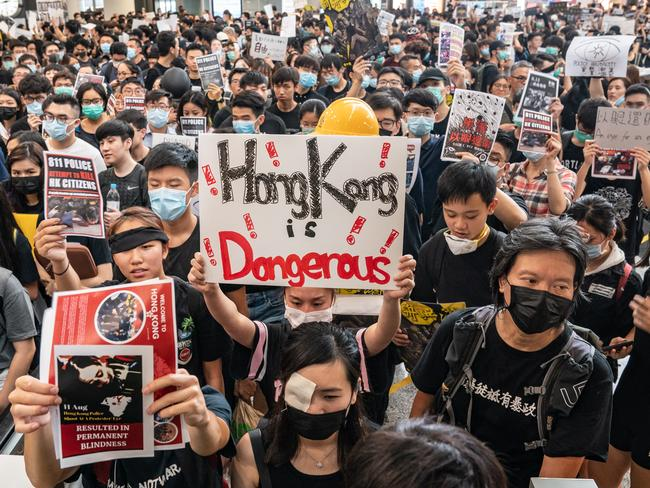 Protesters occupy the arrival hall of the Hong Kong International Airport. Picture: Getty Images