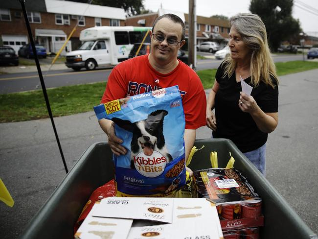 Connie Cruz and her nephew Doug Boyle donate dog food to rescued beagles at the The Lehigh County Humane Society. Picture: AP