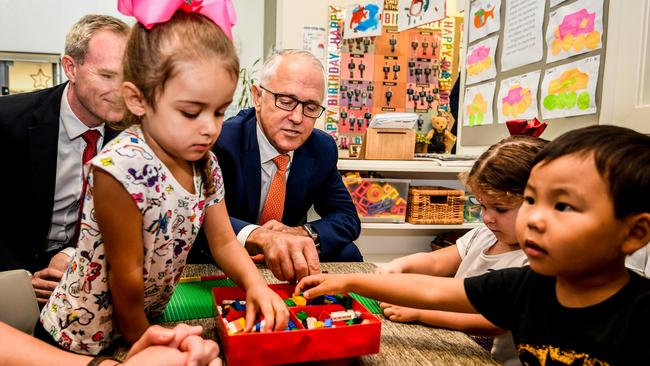 Australian Prime Minister Malcolm Turnbull (centre) speaks to children during a visit to the Teenie Weenies Learning Centre in Panania. Picture: Brendan Esposito/AAP