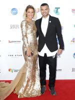 Jules and Guy Sebastian arrive on the red carpet at the ARIA Awards 2014 in Sydney, Australia. Picture: Getty