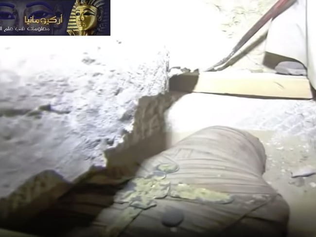 The mummy, thought to be a priest, had a solid gold cross on his chest. Picture: YouTube