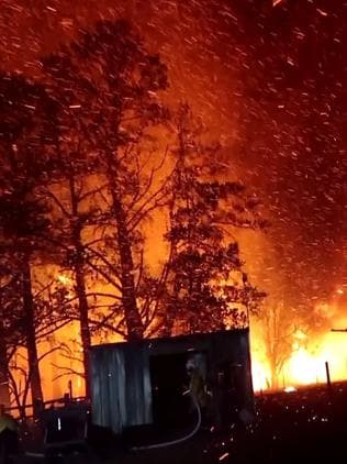 Braddocks Rd, Orangeville, where properties came under ember attack and crown fires across tree tops. Picture: Fire and Rescue NSW