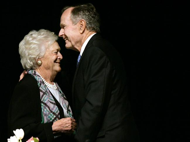Former US president George H.W. Bush embraces former first lady Barbara Bush at a Mother's Day luncheon in Dallas in 2006. Picture: AP