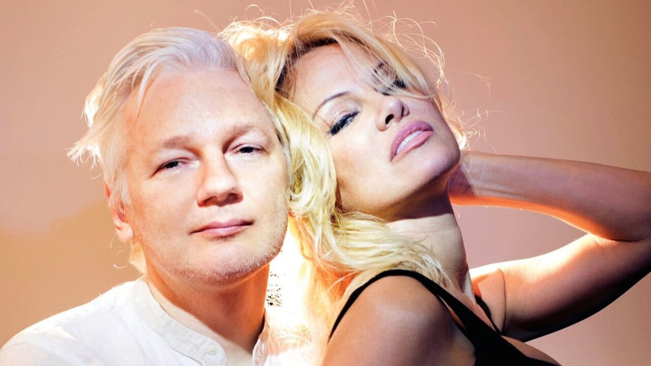 Pamela Anderson strikes a pose with Julian Assange for magazine shoot