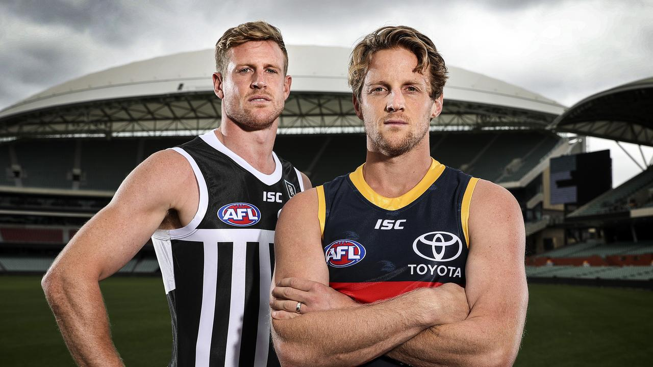Port Adelaide's Tom Jonas and Adelaide's Rory Sloane. Picture: Sarah Reed