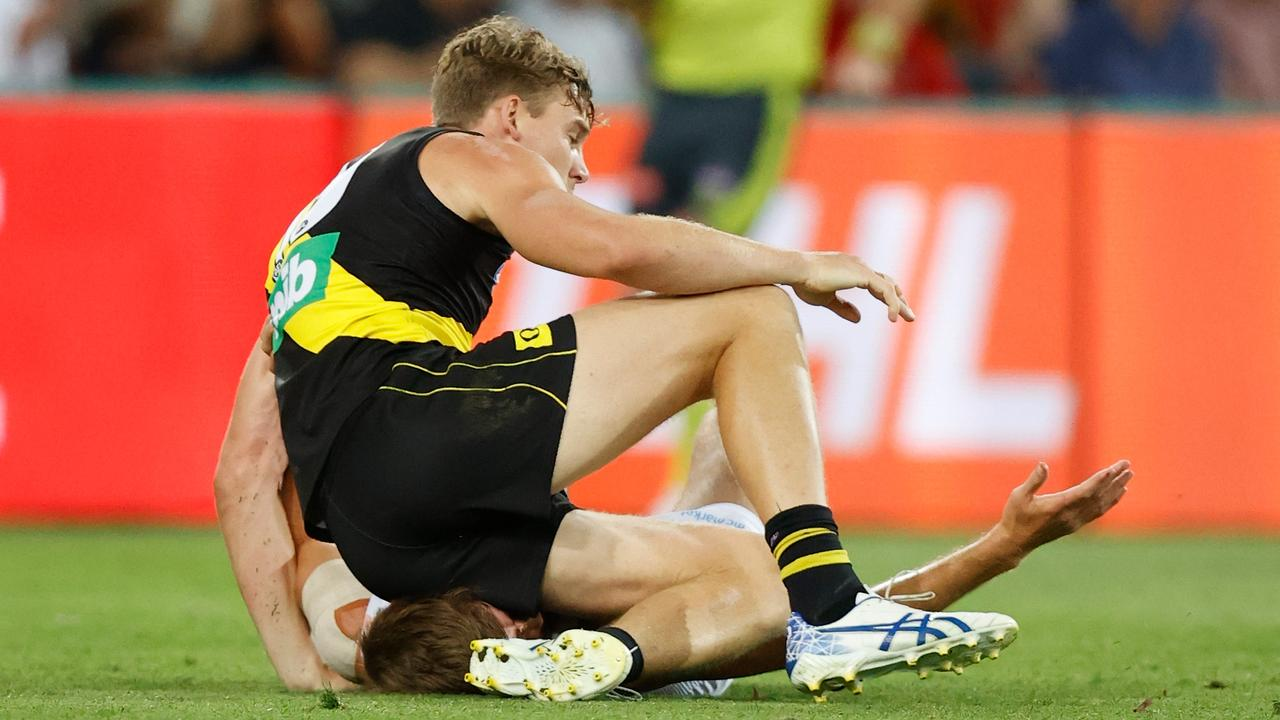 Tom Lynch collected Dougal Howard with his knee just moments after this photo was taken. (Photo by Michael Willson/AFL Photos via Getty Images)