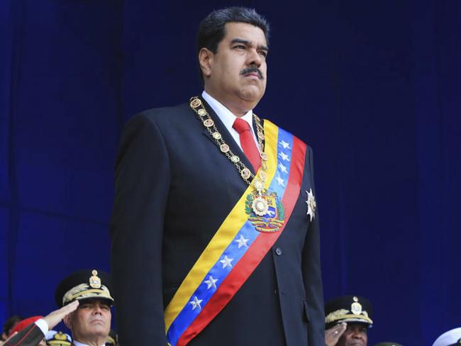 """Authorities have arrested six """"terrorists and hired killers"""" over an alleged assassination attempt on President Nicolas Maduro using explosive-laden drones. Picture: Miraflores Presidential Palace via AP"""