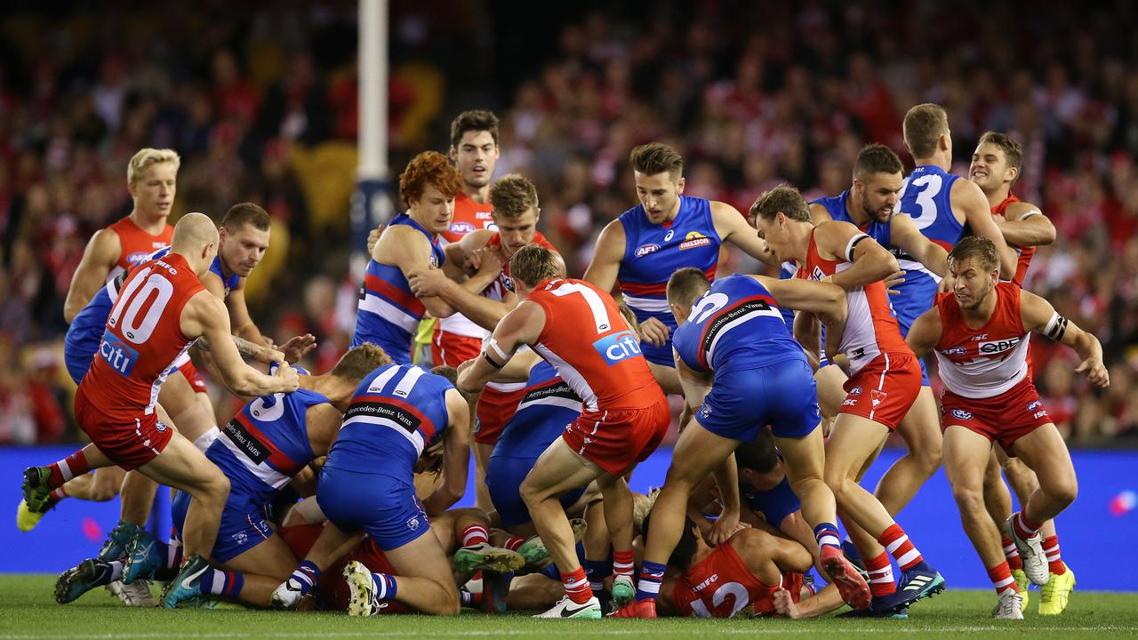 The melee between Sydney and Western Bulldogs players on Saturday night.