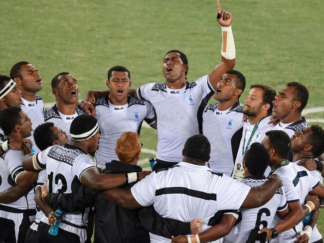 Fiji's players pray after winning the men's rugby sevens gold medal.