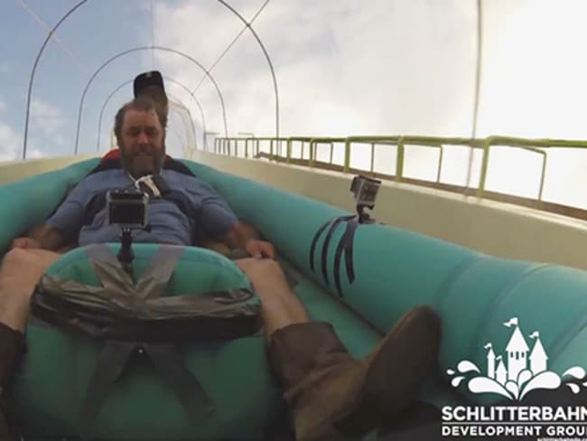 Hold on tight: The riders make their way down the slide.