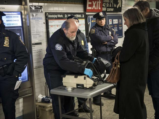 Transport security and police check the bags of passengers as they enter the Times Square after the attempted attack. Picture: Drew Angerer/Getty Images/AFP