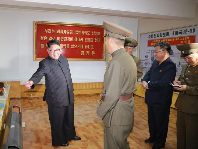 Kim, left, pictured during an August visit to the Chemical Material Institute of Academy of Defense Science. Picture: KCNA/AP