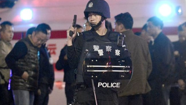 Chinese police in the Yunnan province capital of Kunming (above), where alleged mass murderer Yang Qingpei fled to following the killings Picture: AFP