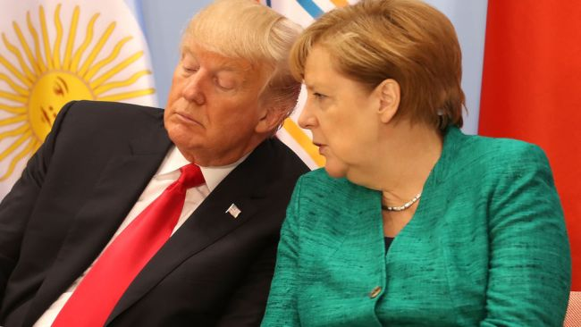 Trump with Angela Merkel at G20 Summit, Hamburg, Germany. July 11, 2017. Photo: Matt Cardy/Getty Images.