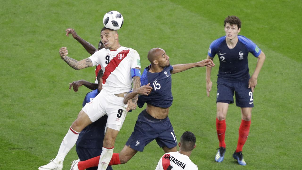 Peru's Paolo Guerrero, left, and France's Steven Nzonzi challenge for the ball